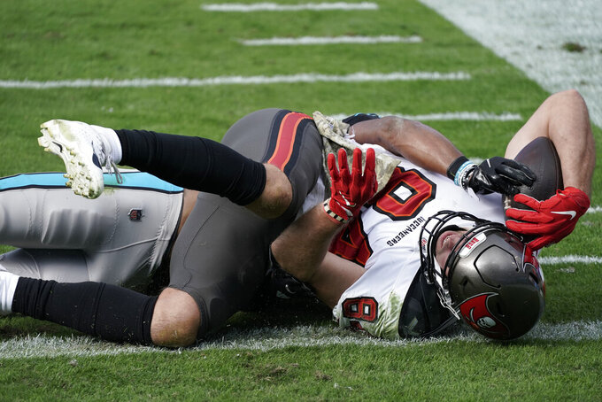 Tampa Bay Buccaneers tight end Cameron Brate (84) falls into the end zone for a touchdown against the Carolina Panthers during the first half of an NFL football game, Sunday, Nov. 15, 2020, in Charlotte , N.C. (AP Photo/Gerry Broome)