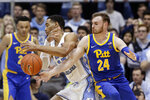 Pittsburgh guard Ryan Murphy (24) pressures North Carolina forward Garrison Brooks (15) during the second half of an NCAA college basketball game in Chapel Hill, N.C., Wednesday, Jan. 8, 2020. (AP Photo/Gerry Broome)