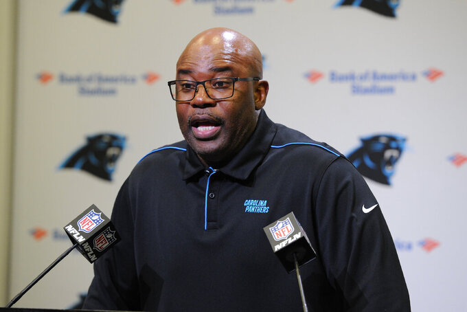 Carolina Panthers head coach Perry Fewell speaks to the media following an NFL football game against the New Orleans Saints in Charlotte, N.C., Sunday, Dec. 29, 2019. (AP Photo/Mike McCarn)