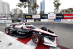 Pole-sitter and second-place finisher Josef Newgarden takes Turn 11 during an IndyCar auto race at the Grand Prix of Long Beach, Sunday, Sept. 26, 2021, in Long Beach, Calif. (AP Photo/Alex Gallardo)