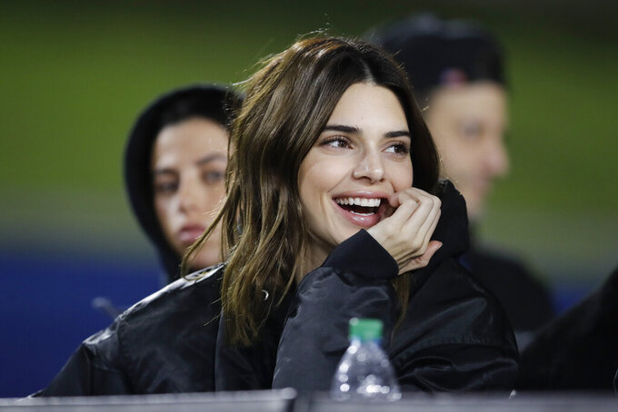 Kendall Jenner watches during the second half of an NFL football game between the Los Angeles Rams and the Baltimore Ravens Monday, Nov. 25, 2019, in Los Angeles. (AP Photo/Marcio Jose Sanchez)
