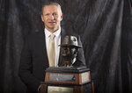 "Army coach Jeff Monken poses for a photograph with the Paul ""Bear"" Bryant Coach of the Year Award, before the ceremony Wednesday, Jan. 9, 2019, in Houston. (Yi-Chin Lee/Houston Chronicle via AP)"