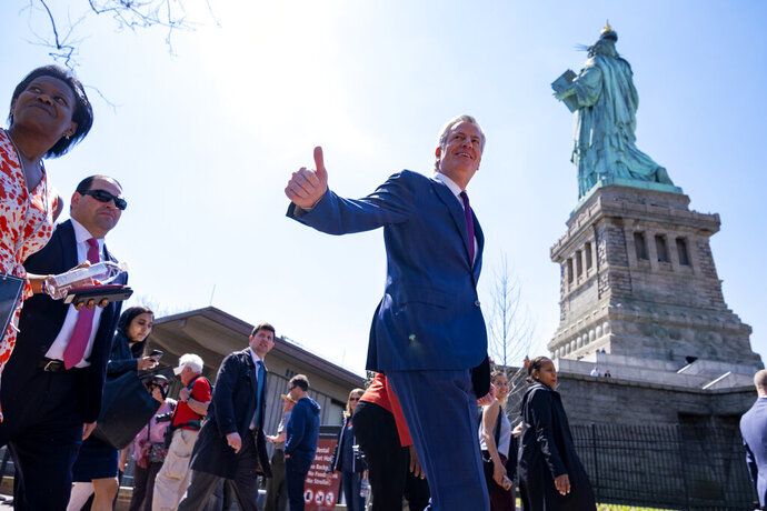 New York Mayor Bill de Blasio arrives for the official dedication ceremony of the Statue of Liberty Museum on Liberty Island Thursday, May 16, 2019, in New York. De Blasio announced Thursday that he will seek the Democratic nomination for president, adding his name to an already long list of candidates itching for a chance to take on Donald Trump. (AP Photo/Craig Ruttle)