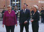 German Chancellor Angela Merkel, left, and French President Emmanuel Macron, center, welcome European Commission President Ursula von der Leyen for a dinner in Toulouse, southwestern France, Wednesday, Oct.16, 2019. President Emmanuel Macron and Chancellor Angela Merkel sought Wednesday to demonstrate the solidity of the French-German relationship at a meeting in southern France, one day before a key EU summit that may approve a divorce deal with Britain.(AP Photo/Frederic Scheiber)