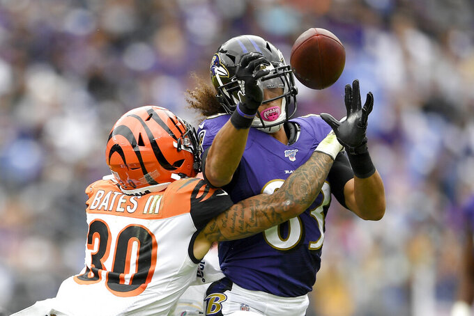 Cincinnati Bengals free safety Jessie Bates (30) breaks up a pass intended for Baltimore Ravens wide receiver Willie Snead (83) during the first half of a NFL football game Sunday, Oct. 13, 2019, in Baltimore. (AP Photo/Nick Wass)