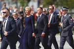 Polish President Andrzej Duda, center right, and his wife Agata Kornhauser-Duda arrive for a memorial ceremony marking the 80th anniversary of the start of World War II in Warsaw, Poland, Sunday, Sept. 1, 2019. (AP Photo/Petr David Josek)