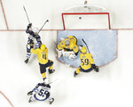 Winnipeg Jets center Paul Stastny (25) scores a goal against Nashville Predators goalie Juuse Saros (74), of Finland, during the third period in Game 7 of an NHL hockey second-round playoff series Thursday, May 10, 2018, in Nashville, Tenn. The Jets won 5-1, and advanced to the Western Conference final. (AP Photo/Mark Humphrey)