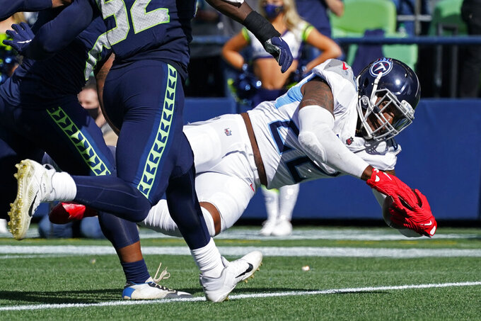 Tennessee Titans running back Derrick Henry dives for touchdown against the Seattle Seahawks during the second half of an NFL football game, Sunday, Sept. 19, 2021, in Seattle. (AP Photo/Elaine Thompson)