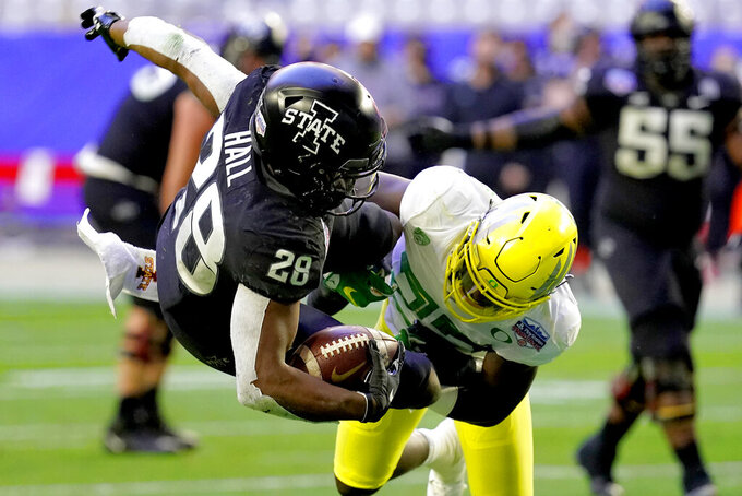 Iowa State running back Breece Hall (28) is hit by Oregon safety Verone McKinley III during the first half of the Fiesta Bowl NCAA college football game, Saturday, Jan. 2, 2021, in Glendale, Ariz. (AP Photo/Ross D. Franklin)