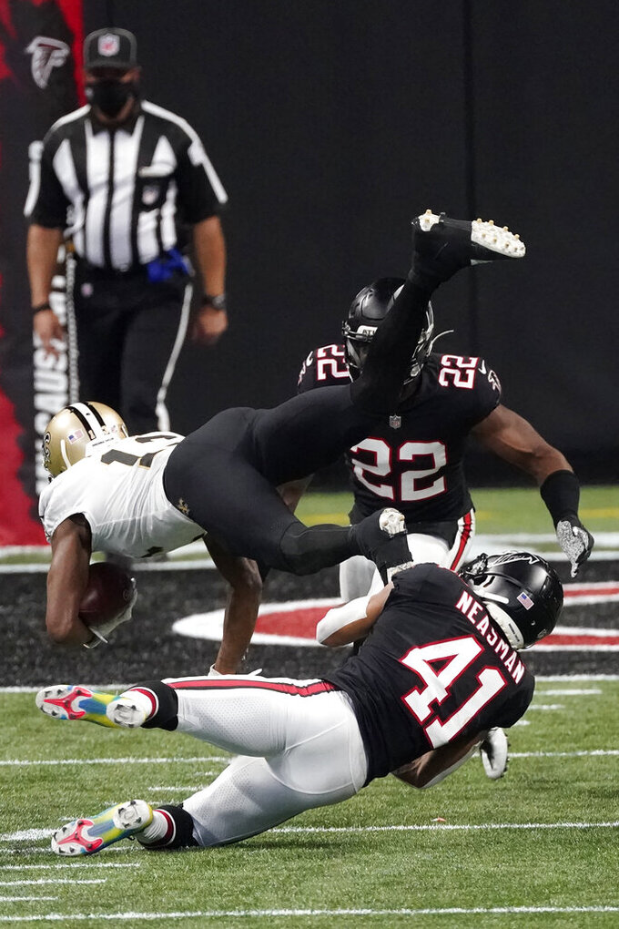 New Orleans Saints wide receiver Michael Thomas (13) makes a catch against the Atlanta Falcons during the second half of an NFL football game, Sunday, Dec. 6, 2020, in Atlanta. (AP Photo/John Bazemore)