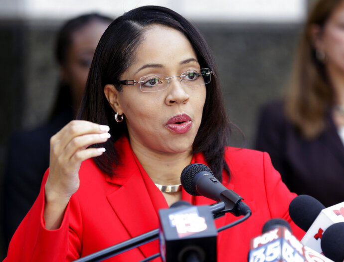 "FILE - In this Sept. 1, 2017 file photo, Florida State Attorney Aramis Ayala answers questions during a news conference in Orlando, Fla. The Florida prosecutor who got into a legal fight with the governor for her blanket refusal to seek the death penalty now says her office will no longer request monetary bail bonds for defendants accused of low-level crimes. ""By primarily relying on money, our bail system has created a poverty penalty that unjustifiably discriminates against those without resources to pay,"" Ayala said in a statement Wednesday, May 16, 2018 announcing the change. (AP Photo/John Raoux, file)"