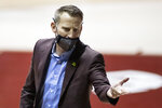 Alabama head coach Nate Oats signals his team during the first half of an NCAA basketball game against Vanderbilt on Saturday, Feb. 20, 2021, in Tuscaloosa, Ala. (AP Photo/Vasha Hunt)