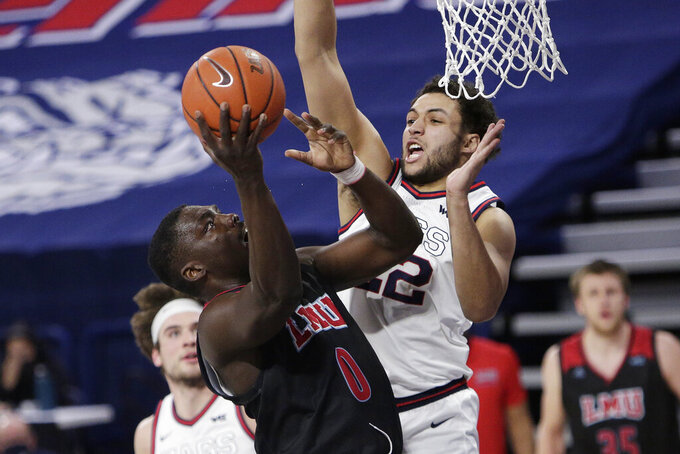 Loyola Marymount guard Eli Scott, left, shoots while pressured by Gonzaga forward Anton Watson during the second half of an NCAA college basketball game in Spokane, Wash., Saturday, Feb. 27, 2021. (AP Photo/Young Kwak)