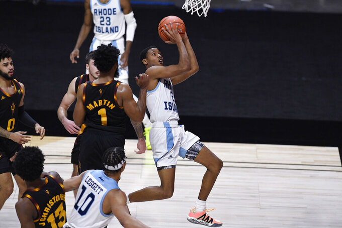 Rhode Island's Jeremy Sheppard drives past Arizona State's Remy Martin for a basket in the second half of an NCAA college basketball game, Wednesday, Nov. 25, 2020, in Uncasville, Conn. (AP Photo/Jessica Hill)