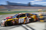 Kyle Busch drives out of his pit during a NASCAR Cup Series auto race at Las Vegas Motor Speedway, Sunday, March 3, 2019, in Las Vegas. (AP Photo/John Locher)