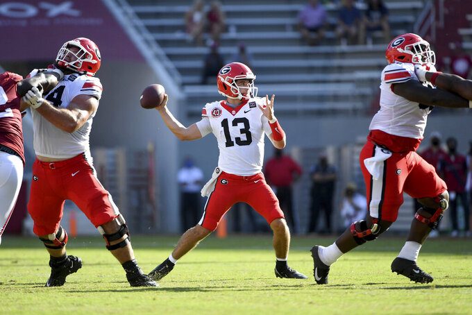 Georgia quarterback Stetson Bennett (13) throws a pass against Arkansas during the first half of an NCAA college football game in Fayetteville, Ark., Saturday, Sept. 26, 2020. (AP Photo/Michael Woods)