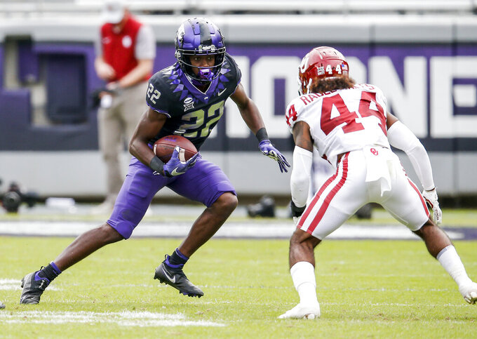 TCU wide receiver Blair Conwright (22) looks for room against Oklahoma defensive back Brendan Radley-Hiles (44) during the second half of an NCAA college football game, Saturday, Oct. 24, 2020, in Fort Worth, Texas. (AP Photo/Brandon Wade)