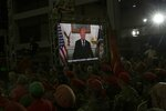 In this Feb. 6, 2019 photo, a recording of President Donald Trump with subtitles is shown on a screen during Diosdado Cabello's weekly, live TV program coined: