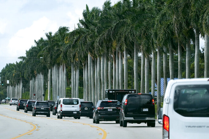 President Donald Trump's motorcade drives to Trump International Golf Club, Thursday, Dec. 24, 2020, in West Palm Beach, Fla. (AP Photo/Patrick Semansky)