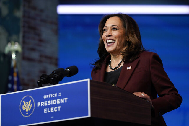 FILE - In this Tuesday, Nov. 24, 2020 file photo, Vice President-elect Kamala Harris speaks as she and President-elect Joe Biden introduce their nominees and appointees to key national security and foreign policy posts at The Queen theater, in Wilmington, Del. Vice President-elect Kamala Harris will be sworn in by Justice Sonia Sotomayor on Wednesday, Jan. 20, 2021, a history-making event in which the first Black, South Asian and female vice president will take her oath of office from the first Latina justice. (AP Photo/Carolyn Kaster, File)