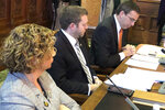 Senators Claire Celsi, Jake Chapman and Roby Smith conduct a subcommittee meeting on a proposed constitutional amendment that would declare there is no right to an abortion under the Iowa Constitution,  at the Iowa Capitol in Des Moines, Iowa, on Thursday, Jan. 16, 2020.  (AP Photo/David Pitt)