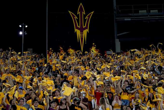 Arizona State fans cheer during the first half of an NCAA college football game against Southern Utah, Thursday, Sept. 2, 2021, in Tempe, Ariz. It was the first game back for fans since the 2019 season. (AP Photo/Matt York)