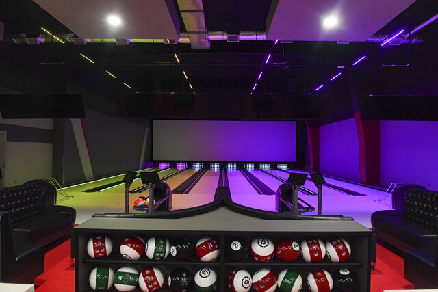 Multicolored lights illuminate a bowling alley at the new indoor entertainment center on Friday, Aug. 7, 2020 at Thunder Road in Sioux Falls, S.D. (Erin Bormett/The Argus Leader via AP)