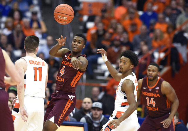 Virginia Tech guard Nahiem Alleyne (4) passes the ball during the team's NCAA college basketball game against Syracuse on Tuesday, Jan. 7, 2020, in Syracuse, N.Y. (Dennis Nett/The Post-Standard via AP)