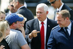 Vice President Mike Pence talks to people after arriving at Dallas Love Field in Dallas on Wednesday, June 13, 2018. Pence is headed to the Kay Bailey Hutchison Dallas Convention Center to speak at the annual meeting of the Southern Baptist Convention. (Vernon Bryant/The Dallas Morning News via AP)