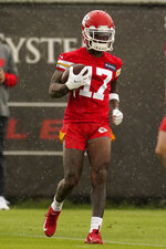 Kansas City Chiefs wide receiver Mecole Hardman runs the ball during the NFL football team's organized team activities Thursday, May 27, 2021, in Kansas City, Mo. (AP Photo/Charlie Riedel)