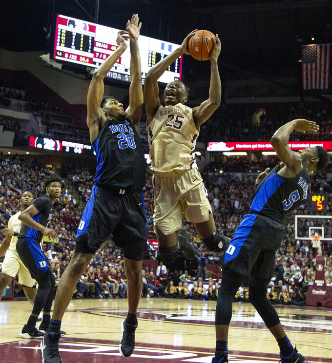 Florida State forward Mfiondu Kabengele goes up for a shot against Duke center Marques Bolden, left, in the second half of an NCAA college basketball game in Tallahassee, Fla., Saturday, Jan. 12, 2019. Duke defeated Florida State 80-78. (AP Photo/Mark Wallheiser)