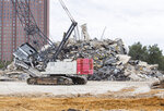This Monday, March 2, 2020 photo shows the remains of the Affiliated Computer Services building or the Leaning to Tower of Dallas. The Leaning Tower of Dallas, the nearly iconic remnant of a high-rise building implosion gone awry, finally collapsed in a cloud of dust Monday after two weeks of being whacked with a headache ball. (Juan Figueroa/The Dallas Morning News via AP)