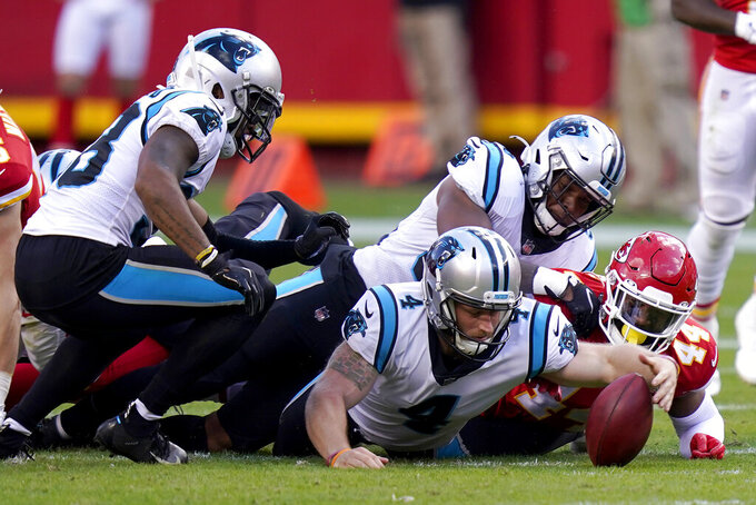 Carolina Panthers kicker Joey Slye (4) reaches for the ball on an on-side kick attempt against the Kansas City Chiefs during the second half of an NFL football game in Kansas City, Mo., Sunday, Nov. 8, 2020. The Chiefs were given possession of the ball after a penalty on Slye. (AP Photo/Orlin Wagner)