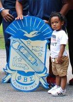 A Phi Beta Sigma Fraternity, Inc. family member poses for a photo during alumnus Louis F. Martin's 104 birthday celebration in Chesterfield, Va., on July 3, 2021 (Kristi K. Higgins/The Progress-Index via AP)