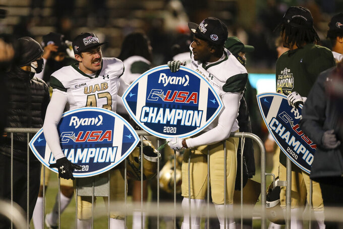 FILE - In this Dec. 18, 2020, file photo, UAB players celebrate after defeating Marshall in the Conference USA Football Championship at Joan C. Edwards Stadium in Huntington, W.Va. UAB will go after its third Conference USA championship in the past four seasons. (Sholten Singer/The Herald-Dispatch via AP, File)