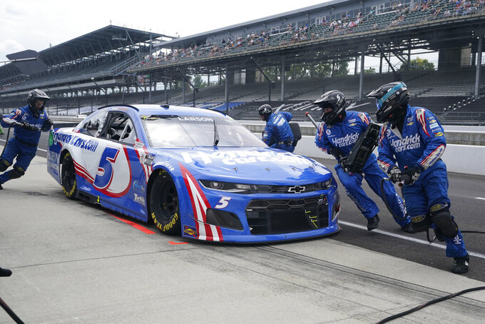 Kyle Larson makes a pit stop during a NASCAR Series auto race at Indianapolis Motor Speedway, Sunday, Aug. 15, 2021, in Indianapolis. (AP Photo/Darron Cummings)