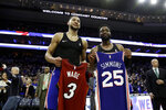 Philadelphia 76ers' Ben Simmons, left, and Miami Heat's Dwyane Wade pose after swapping jerseys following an NBA basketball game Thursday, Feb. 21, 2019, in Philadelphia. Philadelphia won 106-102. (AP Photo/Matt Slocum)