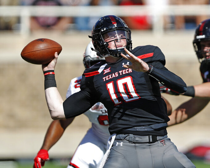 FILE - In this Sept. 8, 2018, file photo, Texas Tech's Alan Bowman throws a pass against Lamar during an NCAA college football game in Lubbock, Texas. Bowman was tearing it up as a freshman for the Red Raiders until a partially collapsed lung ultimately limited him to eight games. He passed for 2,638 and 17 touchdowns in those games and after he was gone so were the Red Raiders bowl chances. (Brad Tollefson/Lubbock Avalanche-Journal via AP, File)