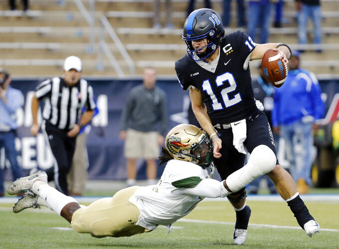 Middle Tennessee quarterback Brent Stockstill (12) is sacked by UAB linebacker Tre' Crawford for a 12-yard loss in the second half of the NCAA Conference USA championship college football game Saturday, Dec. 1, 2018, in Murfreesboro, Tenn. (AP Photo/Mark Humphrey)