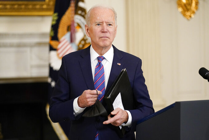 President Joe Biden leaves after speaking about the March jobs report in the State Dining Room of the White House, Friday, April 2, 2021, in Washington. (AP Photo/Andrew Harnik)