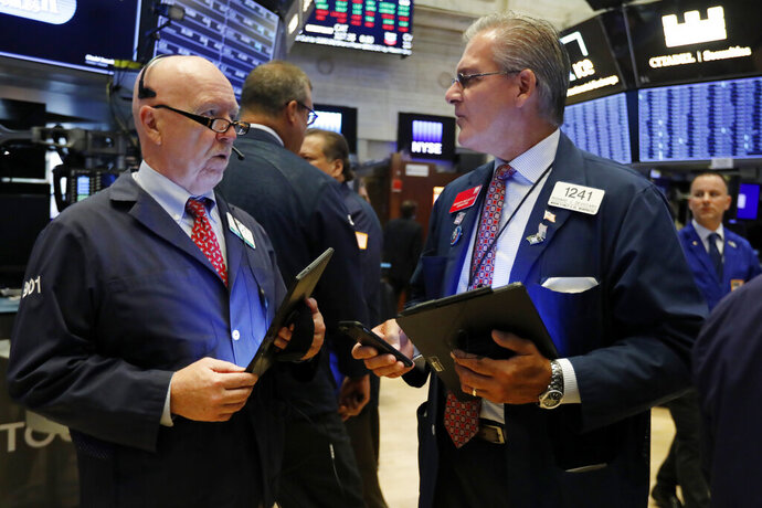 FILE - In this Sept. 4, 2019, file photo traders John Doyle, left, and Richard Deviccaro work on the floor of the New York Stock Exchange. The U.S. stock market opens at 9:30 a.m. EDT on Thursday, Sept. 12. (AP Photo/Richard Drew, File)