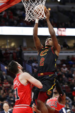 Cleveland Cavaliers guard Collin Sexton, right, drives to the basket against Chicago Bulls guard Tomas Satoransky during the second half of an NBA basketball game in Chicago, Saturday, Jan. 18, 2020. (AP Photo/Nam Y. Huh)