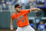 Baltimore Orioles pitcher Dylan Bundy throws to a Kansas City Royals batter in the first inning of a baseball game at Kauffman Stadium in Kansas City, Mo., Saturday, Aug. 31, 2019. (AP Photo/Colin E. Braley)