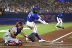 Toronto Blue Jays' Bo Bichette hits an RBI-single to score George Springer during the fourth inning of a baseball game against the Boston Red Sox on Monday, July 19, 2021, in Buffalo, N.Y. (AP Photo/Joshua Bessex)