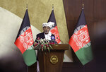 Afghan President Ashraf Ghani speaks at the extraordinary meeting of the Parliament in Kabul, Afghanistan, Monday, Aug. 2, 2021. (AP Photo/Rahmat Gul)