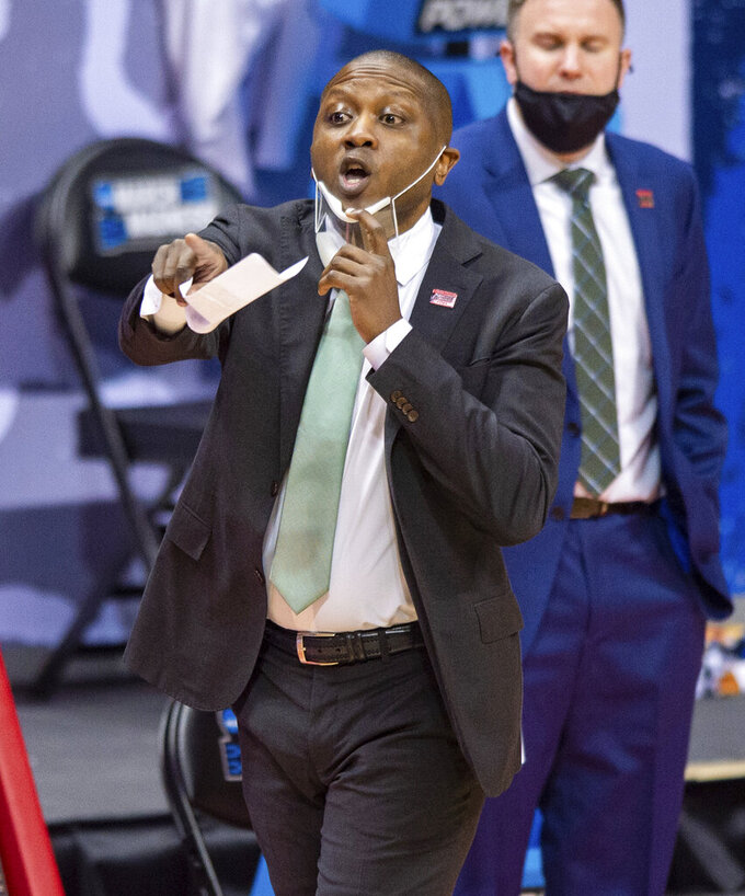 Cleveland State head coach Dennis Gates reacts to the action on the court during the first half of a first-round game against Houston in the NCAA men's college basketball tournament, Friday, March 19, 2021, at Assembly Hall in Bloomington, Ind. (AP Photo/Doug McSchooler)