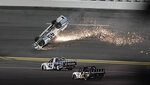Ty Majeski (45) skids upside down after wrecking during the NASCAR Truck Series auto race at Daytona International Speedway, Friday, Feb. 14, 2020, in Daytona Beach, Fla. (AP Photo/Chris O'Meara)