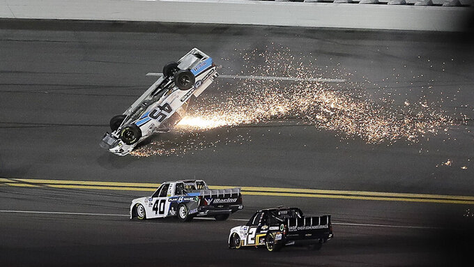 Ty Majeski (45) skids upside down after wrecking during the NASCAR Truck Series auto race at Daytona International Speedway, Friday, Feb. 14, 2020, in Daytona Beach, Fla. (AP Photo/Chris O'Meara)
