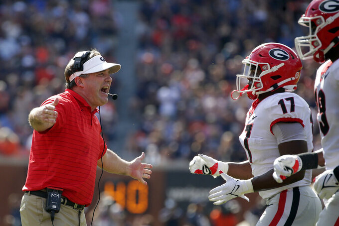 Georgia head coach Kirby Smart celebrates after a defensive stop during the first half of an NCAA college football game against Auburn, Saturday, Oct. 9, 2021, in Auburn, Ala. (AP Photo/Butch Dill)