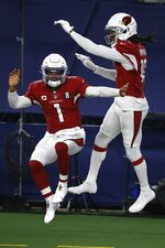 Arizona Cardinals' Kyler Murray (1) and DeAndre Hopkins (10) celebrate a touchdown scored on a carry by Murray in the second half of an NFL football game against the Dallas Cowboys in Arlington, Texas, Monday, Oct. 19, 2020. (AP Photo/Ron Jenkins)